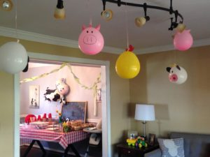 diy farm theme party with farm animal balloons